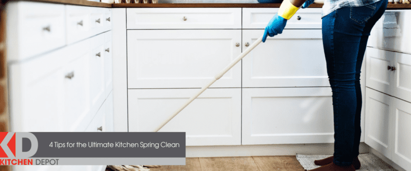 a woman cleaning the kitchen with a mop
