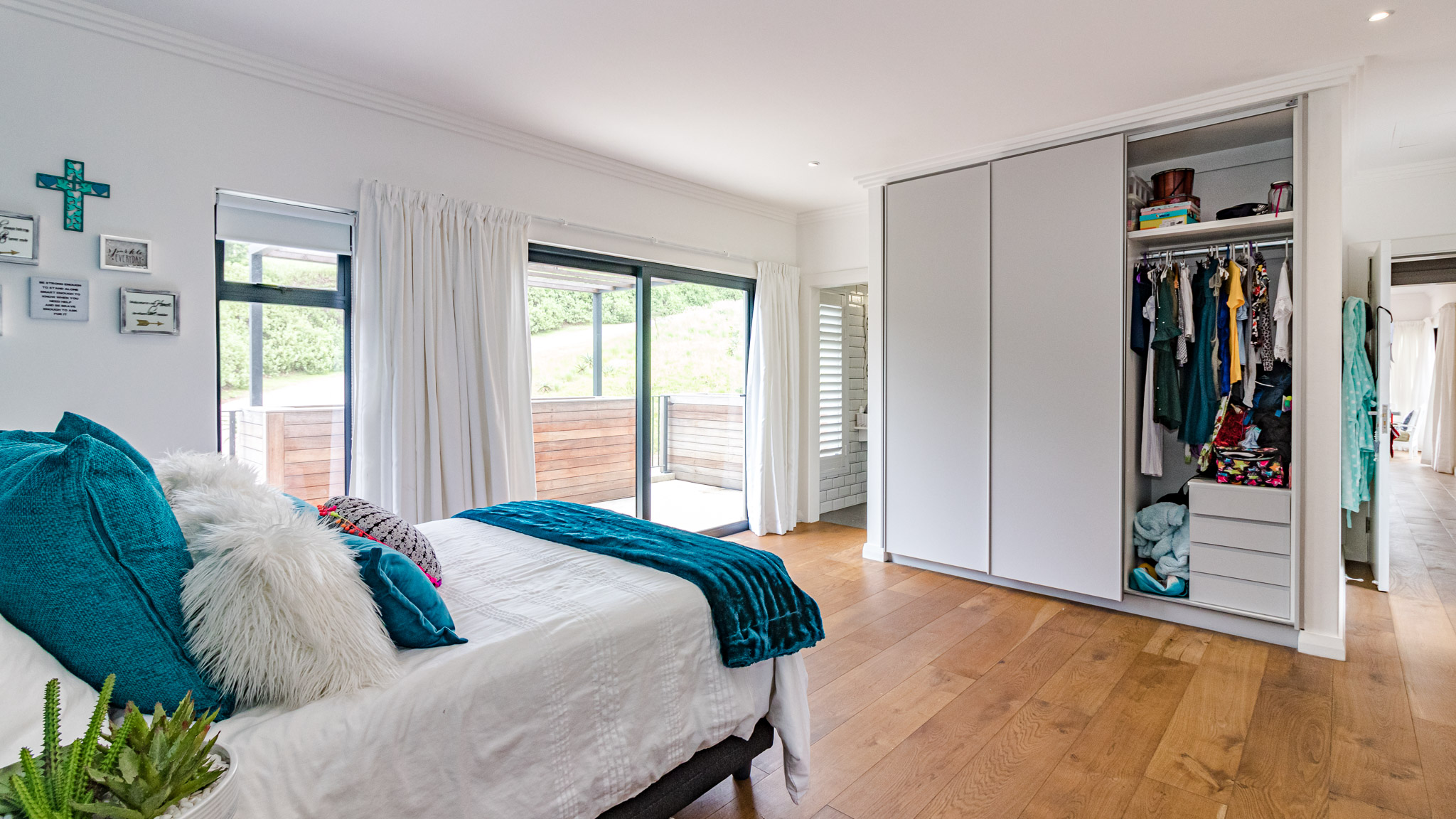 White Bedroom with built in cupboards