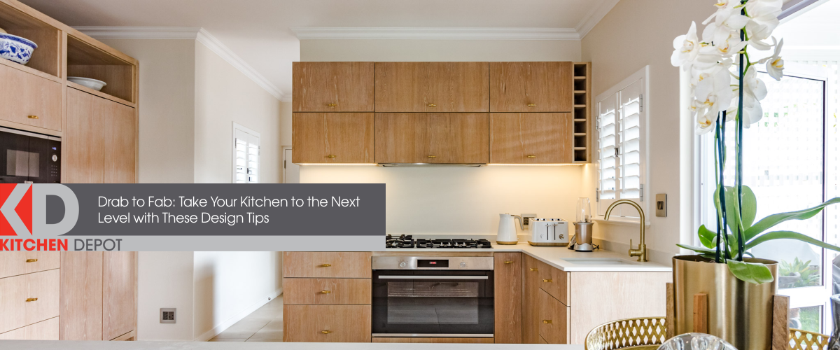 A large, open-plan kitchen installed by Kitchen Depot that has light wood, white and gold accents